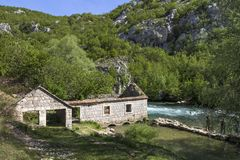 Idyllic river atmosphere. Ruins of old grain mill on river Ruda near town Trilj and Sinj in croatia Stock Photo