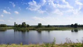 Idyllic riverbank landscape Stock Image