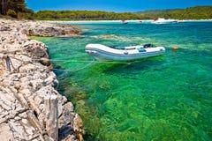 Idyllic rocky beach Sakarun and small boat on Dugi Otok island Royalty Free Stock Photos