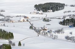 Lovely rural countryside on snowy winter day. Aerial view of barnyards and farm. Weitnau, Allgau, Bavaria, Germany. Idyllic rural countryside on snowy winter Stock Photo