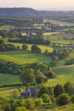 Idyllic rural farmland, Cotswolds UK. Idyllic rural view of gently rolling patchwork farmland and villages with pretty wooded boundaries, in the beautiful Stock Images