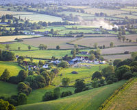 Idyllic rural farmland, Cotswolds UK. Idyllic rural view of gently rolling patchwork farmland and villages with pretty wooded boundaries, in the beautiful Stock Photography