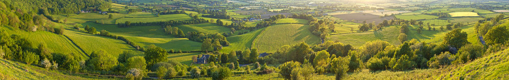 Idyllic rural landscape, Cotswolds UK. Idyllic rural view of gently rolling patchwork farmland and villages with pretty wooded boundaries, in the beautiful Royalty Free Stock Images