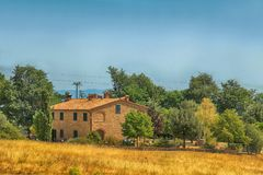Rural Tuscan landscape with farmhouse, Italy. Idyllic rural Tuscan landscape with farmhouse, Tuscany, Italy, Europe stock image