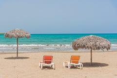 Beach umbrellas on Caribbean sea Royalty Free Stock Photography