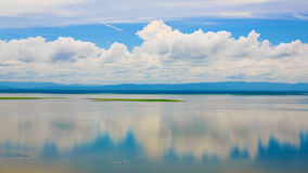 Idyllic scenery of sky reflected in the river Royalty Free Stock Photo