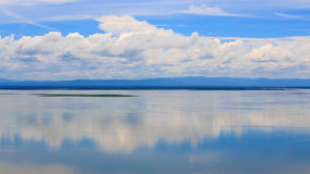 Idyllic scenery of sky reflected in the river Stock Photography