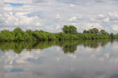 Idyllic scenery of sky reflected in the river Royalty Free Stock Photography