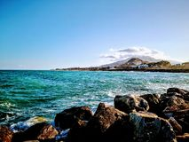 Idyllic seascape against city in Torrevieja, Spain. stock photography