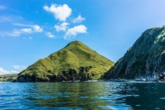 Idyllic seascape from Padar Island, Indonesia. Idyllic seascape from Indonesia with the rock formations of Padar Island reflected in the rippled surface of the royalty free stock photos