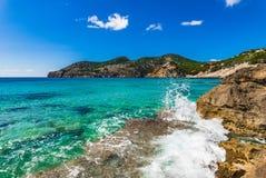 Idyllic seaside landscape nature at bay of Camp de Mar, Mallorca, Spain. Beautiful seascape with breaking wave on rocks on Majorca island, Mediterranean Sea Stock Photography