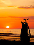 Idyllic shot of sunset and golf clubs Royalty Free Stock Images