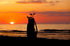 Idyllic shot of sunset and golf clubs Stock Photo