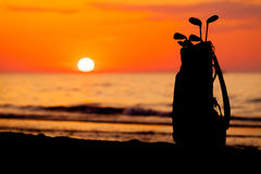 Idyllic shot of sunset and golf clubs Stock Photos