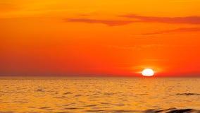 Idyllic shot of sunset by the sea Royalty Free Stock Photos