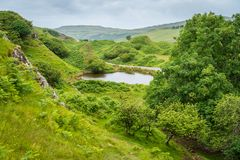 The famous Fairy Glen, located in the hills above the village of Uig on the Isle of Skye in Scotland. Idyllic small glen located in the hills above the village Royalty Free Stock Photo