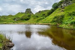 The famous Fairy Glen, located in the hills above the village of Uig on the Isle of Skye in Scotland. Idyllic small glen located in the hills above the village Stock Photos