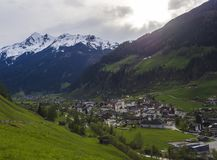 Idyllic spring mountain rural landscape. View over Stubaital or Stubai Valley near Innsbruck, Austria with village. Neustift im Stubaital, church, green meadow stock image