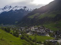 Idyllic spring mountain rural landscape. View over Stubaital or Stubai Valley near Innsbruck, Austria with village. Neustift im Stubaital, church, green meadow stock images