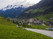 Idyllic spring mountain rural landscape. View over Stubaital or Stubai Valley near Innsbruck, Austria with village. Neustift im Stubaital, church, green meadow royalty free stock photos