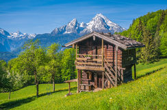 Idyllic springtime landscape in the Alps with traditional mountain lodge Royalty Free Stock Image