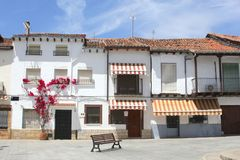 Scenic Spanish village in Moorish style, Spain. Idyllic square with a couch, bougainvillea and white houses in the village Candeleda in Andalusian and Moorish Royalty Free Stock Photos