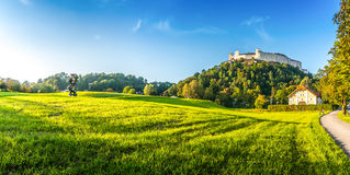 Idyllic summer fields with Fortress Hohensalzburg at sunset, Salzburg, Austria Royalty Free Stock Images