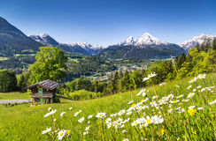 Idyllic summer landscape in the Alps with mountain cottage Stock Photo