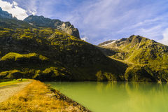 Idyllic summer landscape with clear mountain lake Royalty Free Stock Photo