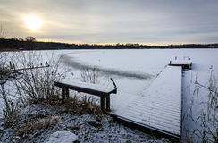 Idyllic sunrise over Swedish frozen lake Stock Image