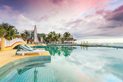 Idyllic sunset on holidays in Thailand. Tropical resort with swimming pool at sunset, Thailand Stock Photo
