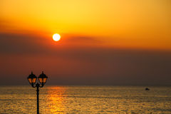 Idyllic sunset by the sea stock images