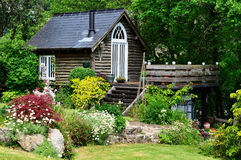 Idyllic timber garden hideaway Stock Photography