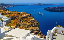Idyllic top view from hotel on bay, Santorini island in Greece. Idyllic top view on bay Caldera sea with cruise ship awaiting. Santorini island in Greece royalty free stock photo