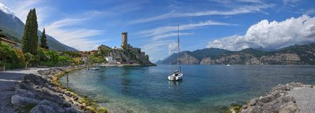 Idyllic tourist destination malcesine. lakeside promenade with v. Idyllic tourist destination malcesine. lakeside promenade with bathing beach and view to stock images