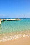 Idyllic tropical beach. Scenic view of boat and pier with idyllic tropical beach in foreground Royalty Free Stock Images