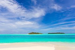 Idyllic tropical beach. Scenic view of idyllic tropical beach with turquoise sea, islands and cloudscape, Maldives Stock Images