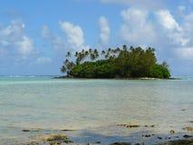 Idyllic tropical beach and atoll in Rarotonga. Idyllic tropical beach and palm tree covered atoll at Muri Lagoon on Rarotonga, Cook Islands Royalty Free Stock Photography