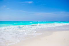 Idyllic tropical beach on Cuba in Caribbean with white sand, turquoise ocean water and blue sky Stock Photography