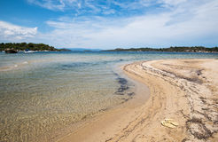 Idyllic tropical beach Halkidiki Greece. Idyllic tropical beach with gold sand and deep blue calm waters  at Halkidiki, Greece. Concept of summer vacations Stock Images