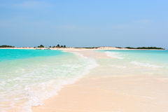 Idyllic tropical beach with perfect turquoise water Stock Photo