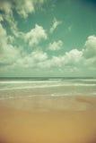 Idyllic tropical beach. Idyllic tropical sand beach background. Toned image Royalty Free Stock Photo