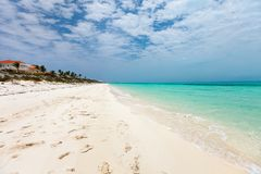 Idyllic beach at Caribbean. Idyllic tropical beach with white sand, turquoise ocean water and blue sky on Caribbean island Stock Photography