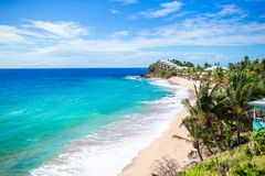 Idyllic tropical beach with white sand, turquoise ocean water and blue sky on Caribbean island. Idyllic tropical beach with white sand, turquoise ocean water and Royalty Free Stock Images