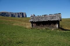 Idyllic view on alp in the dolomites with wooden cabin / alp de siusi / val gardena / south tyrol Stock Photo