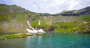 Idyllic view of Balea Lake shore in Fagaras Mountains Stock Photography