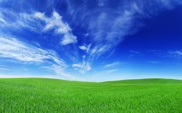 Idyllic view, green hills and blue sky. Idyllic landscape, green field, blue sky and white clouds royalty free stock photos