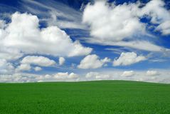 Idyllic view, green hills and blue sky. Idyllic landscape, green field, blue sky and white clouds stock photos