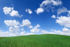 Idyllic view, green hills and blue sky. Idyllic landscape, view on green fields, blue sky and white clouds royalty free stock photography