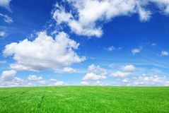 Idyllic view, green hills and blue sky. Idyllic landscape, view on green fields, blue sky and white clouds stock photography